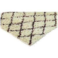 Angled view of ivory coloured shaggy rug with brown diamond pattern.  Made from eco friendly recycled plastic bottles.
