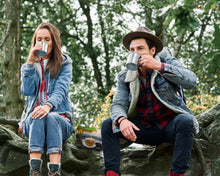 Load image into Gallery viewer, Lightload Puer Tea  2 sitting on rock drinking-lightload tea