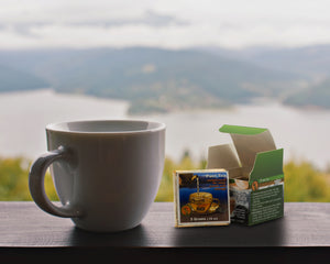 Lightload Puer Tea overlooking mountains with sampler and brick tea-lightload tea