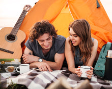 Load image into Gallery viewer, Lightload Puer Tea 2 campers with tent drinking and reading-lightload tea