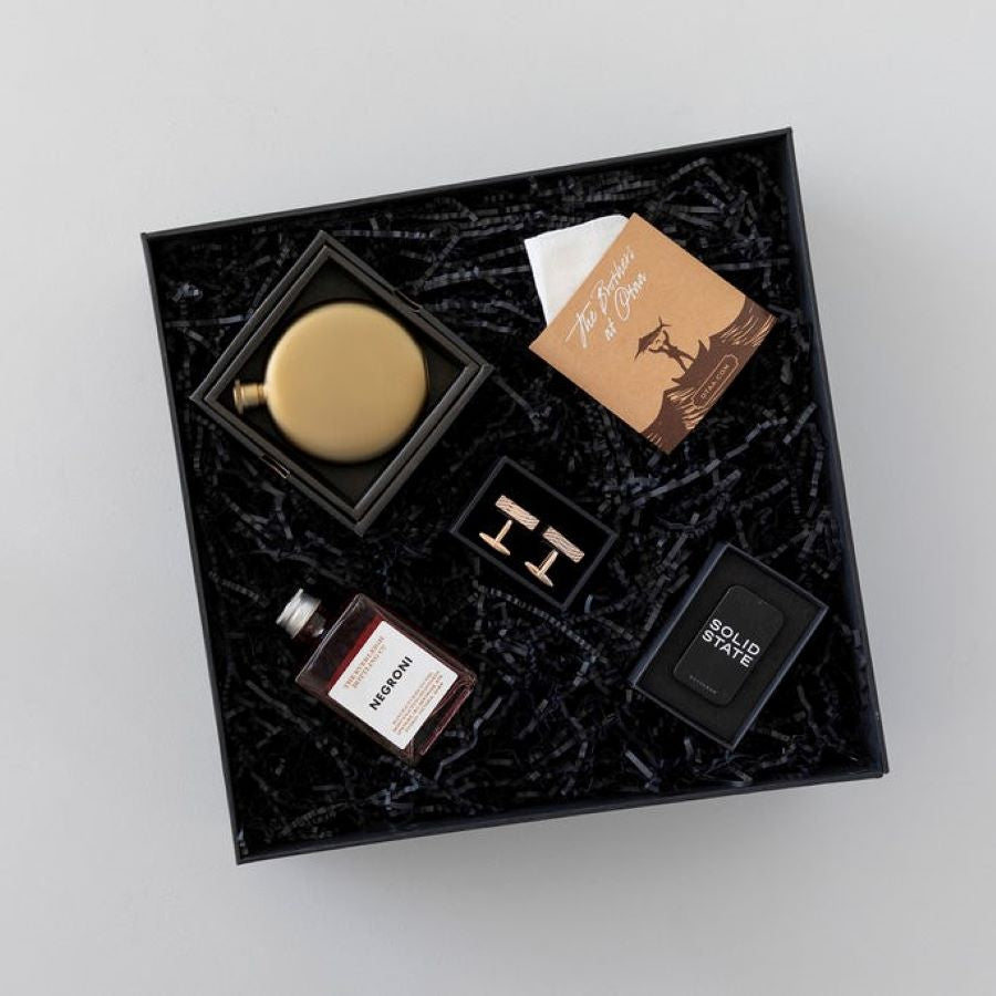 Gift box with gold flask, linen pocket square, gold cufflinks, cocktail and cologne