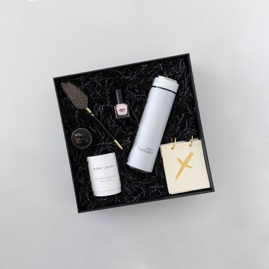 Gift box with feather Pen, leather note pad, scented candle, nail polish and nail polish remover wipes