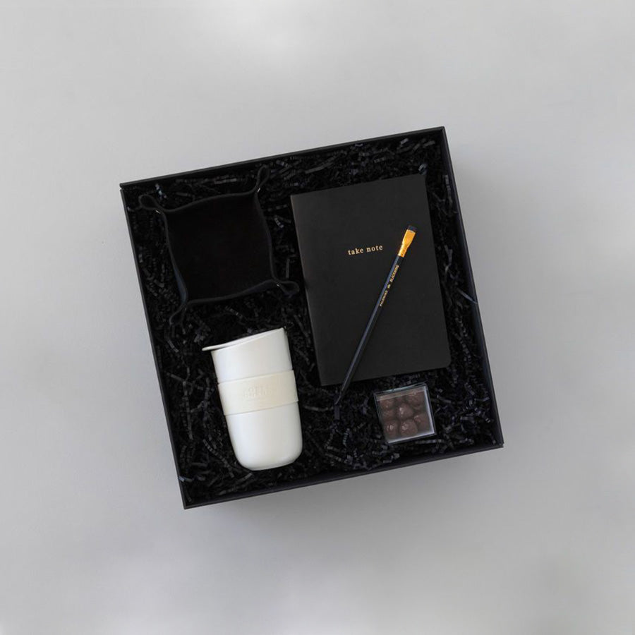 Gift box with leather catchall, note book, travel keep cup, bourbon chocolate, black pencil
