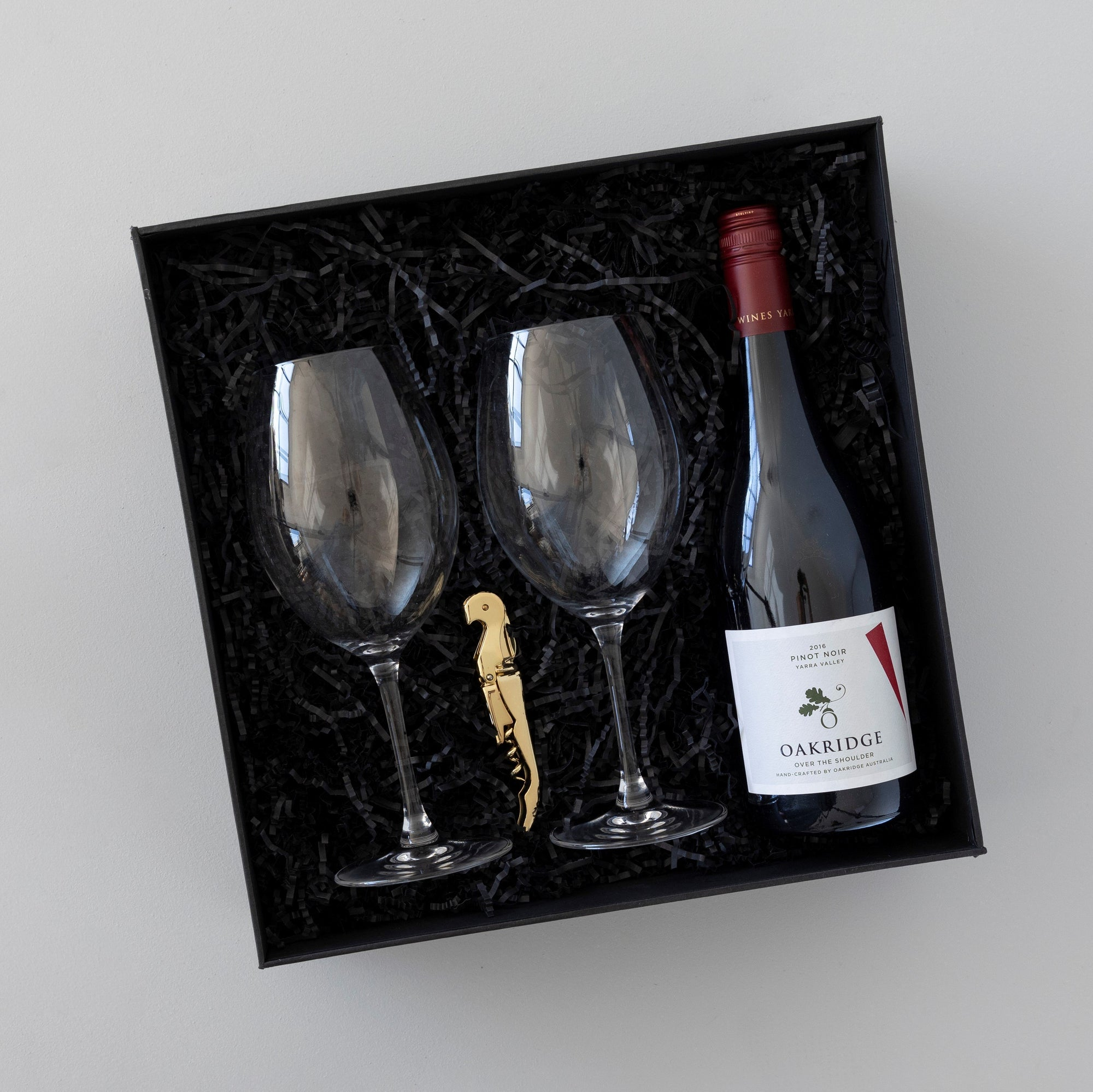 Gift box with crystal wine glasses, wine knife, bottle of red wine