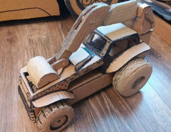 recycled cardboard tractor digger by artist gleznukalns creative studios