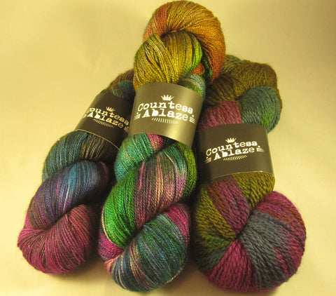 Nerds prefer their rainbows darker on 3 different yarn bases