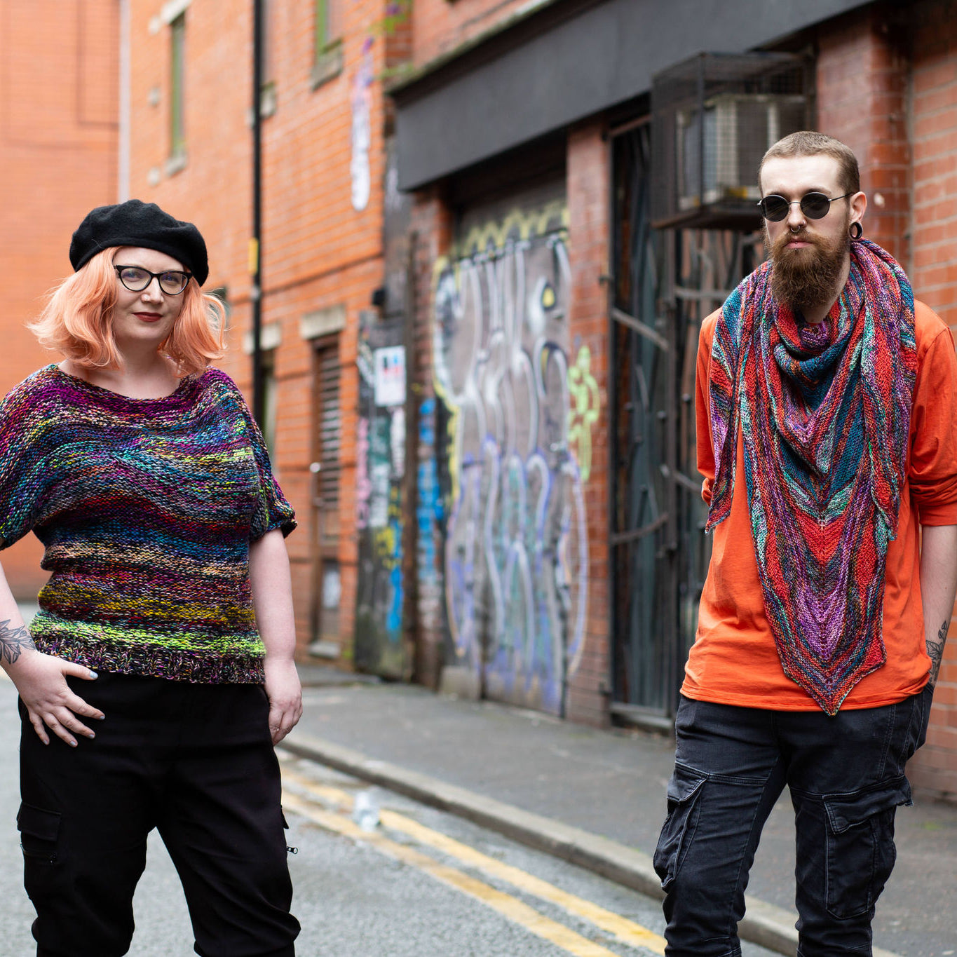 Countess and Haydn in knitwear in the street. Photo by Decoy Media in Manchester's Northern Quarter. Papillon shawl designed by Marin Melchior. Photography by Decor Media, Manchester