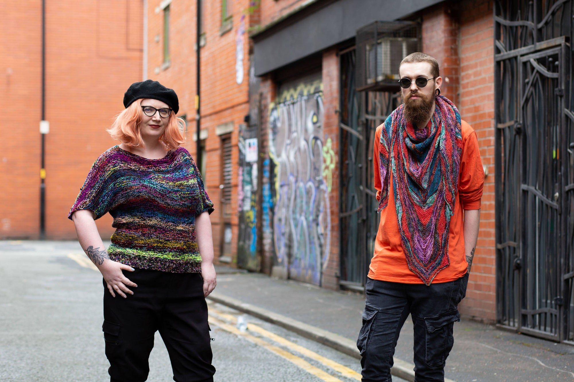 Countess and Haydn in knitwear in the street. Photo by Decoy Media