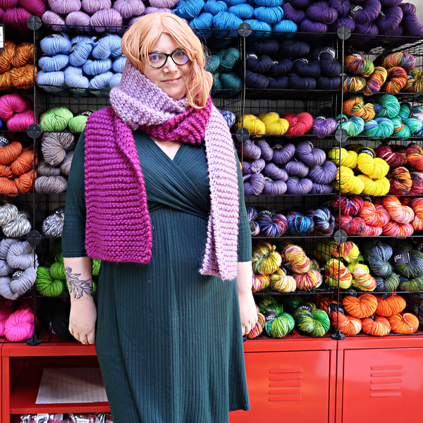 Countess wears a two colour superchunky yarn knitted scarf