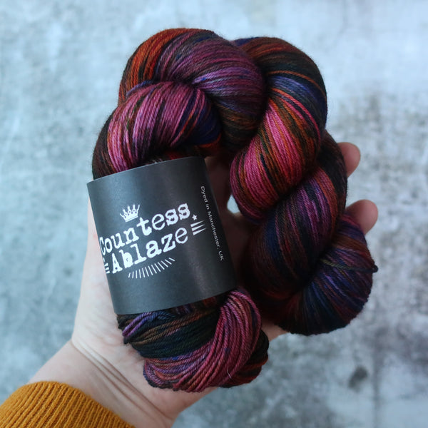Hand-dyed merino 4ply yarn in saturated colours by Countess Ablaze