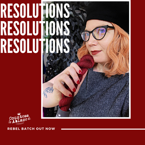 Resolutions - Countess holds a skein of yarn as lipstick