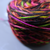 A caked ball of yarn sits on a grey table.