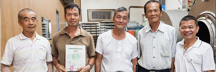 Traditional Dong Ding Oolong Tea master line up for a photo at a recent workshop to pass on traditional tea making skills and knowledge
