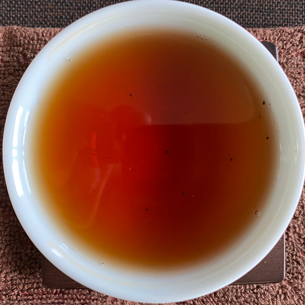 Heavy Roast Wuyi Oolong brewed tea in a cup