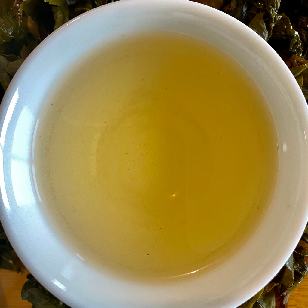 Competition Grade Wuyi Oolong brewed tea in a cup