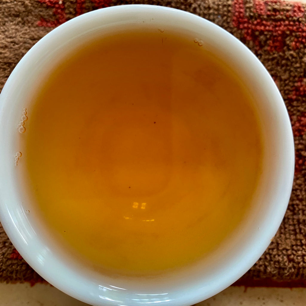 Charcoal Roasted High Mountain Oolong Tea spring 2020 brewed tea in a cup