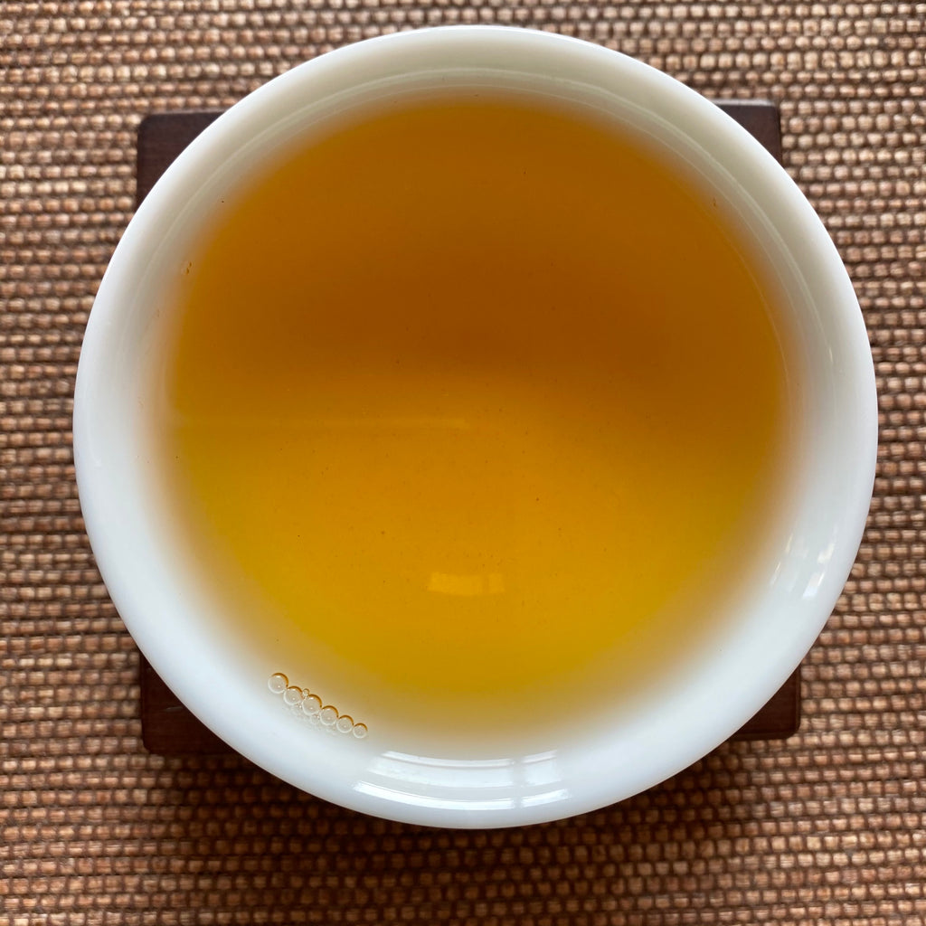 Traditional Dong Ding Oolong brewed tea in a cup