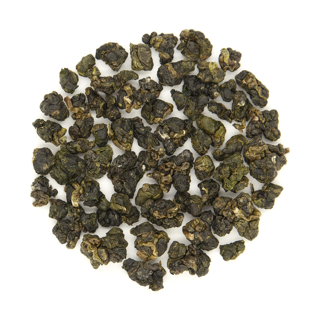 Tightly rolled Alishan High Mountain Jin Xuan Oolong Tea tea leaves with similar shape