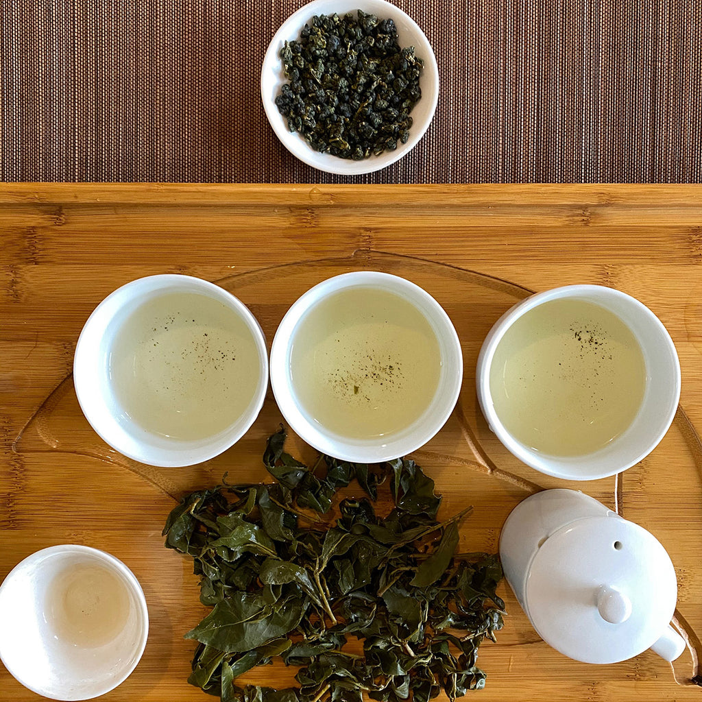 Spring Alishan High Mountain Oolong Tea brewing and leaves