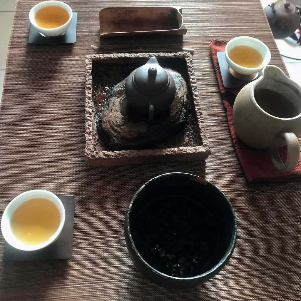 Charcoal Roasted Honey Oolong Tea brewed in a nice layout of tea