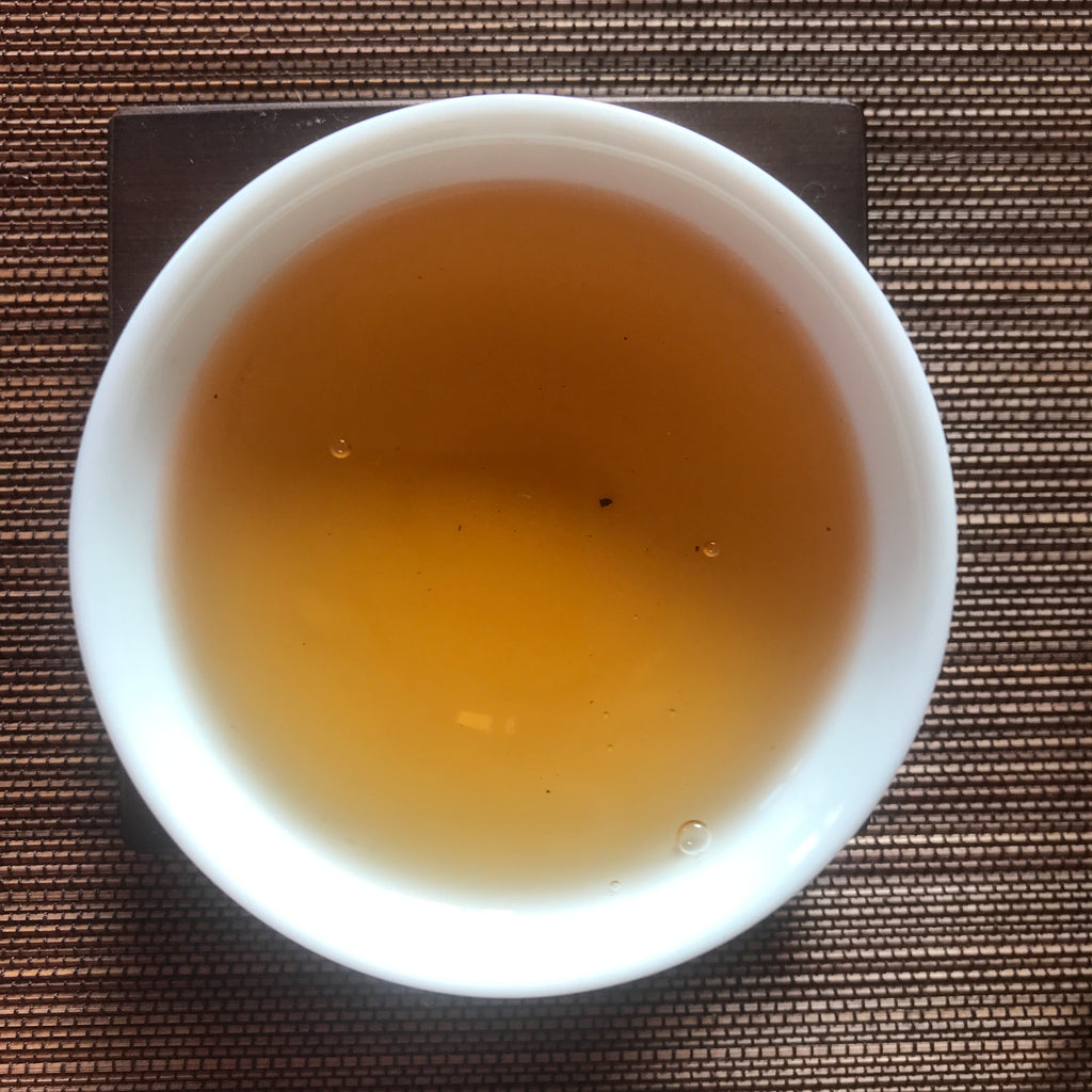 Charcoal Roasted Honey Oolong Tea brewed in a cup