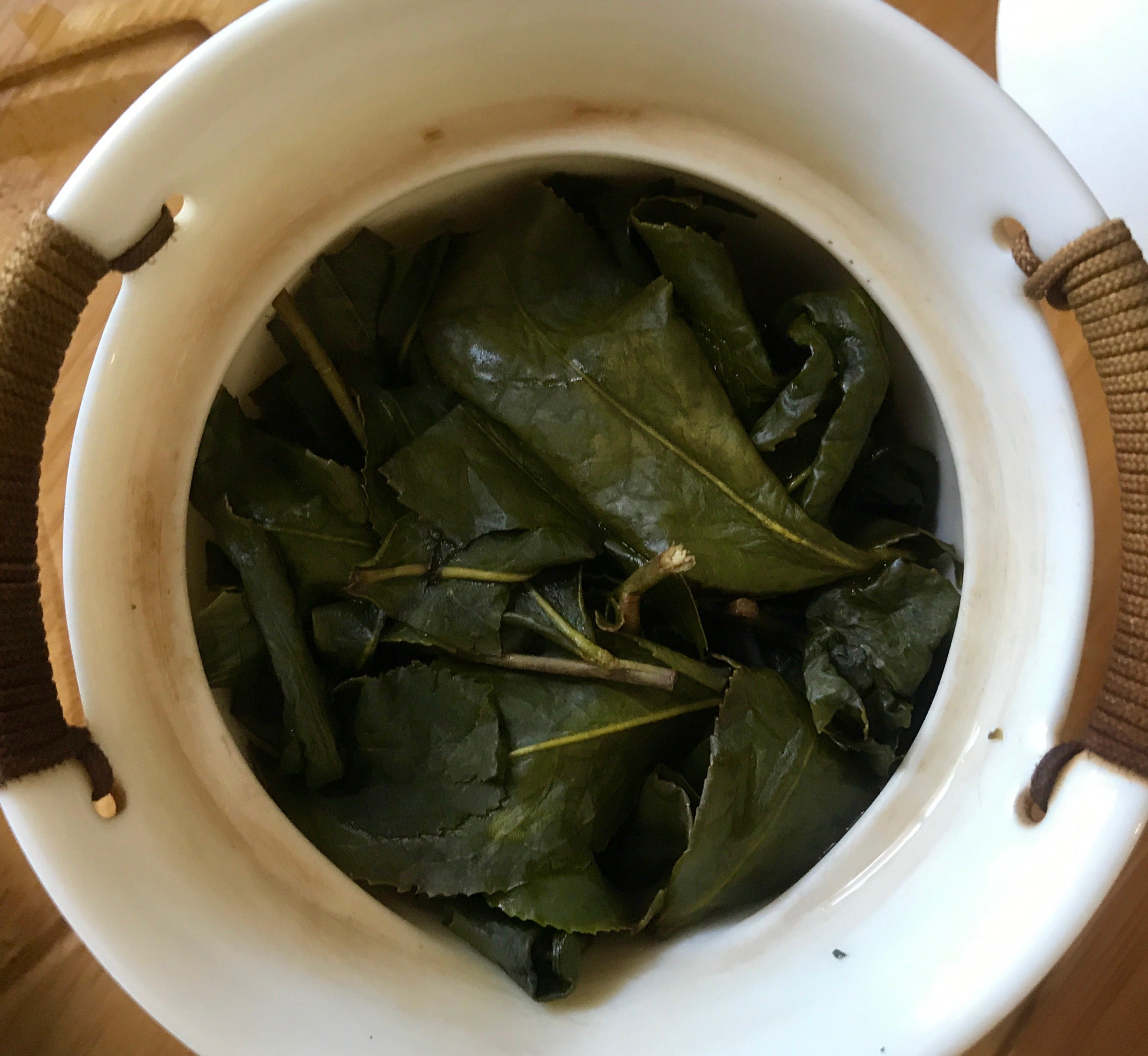 Da Yu LIng High Mountain Tea leaves brewed in a gaiwan