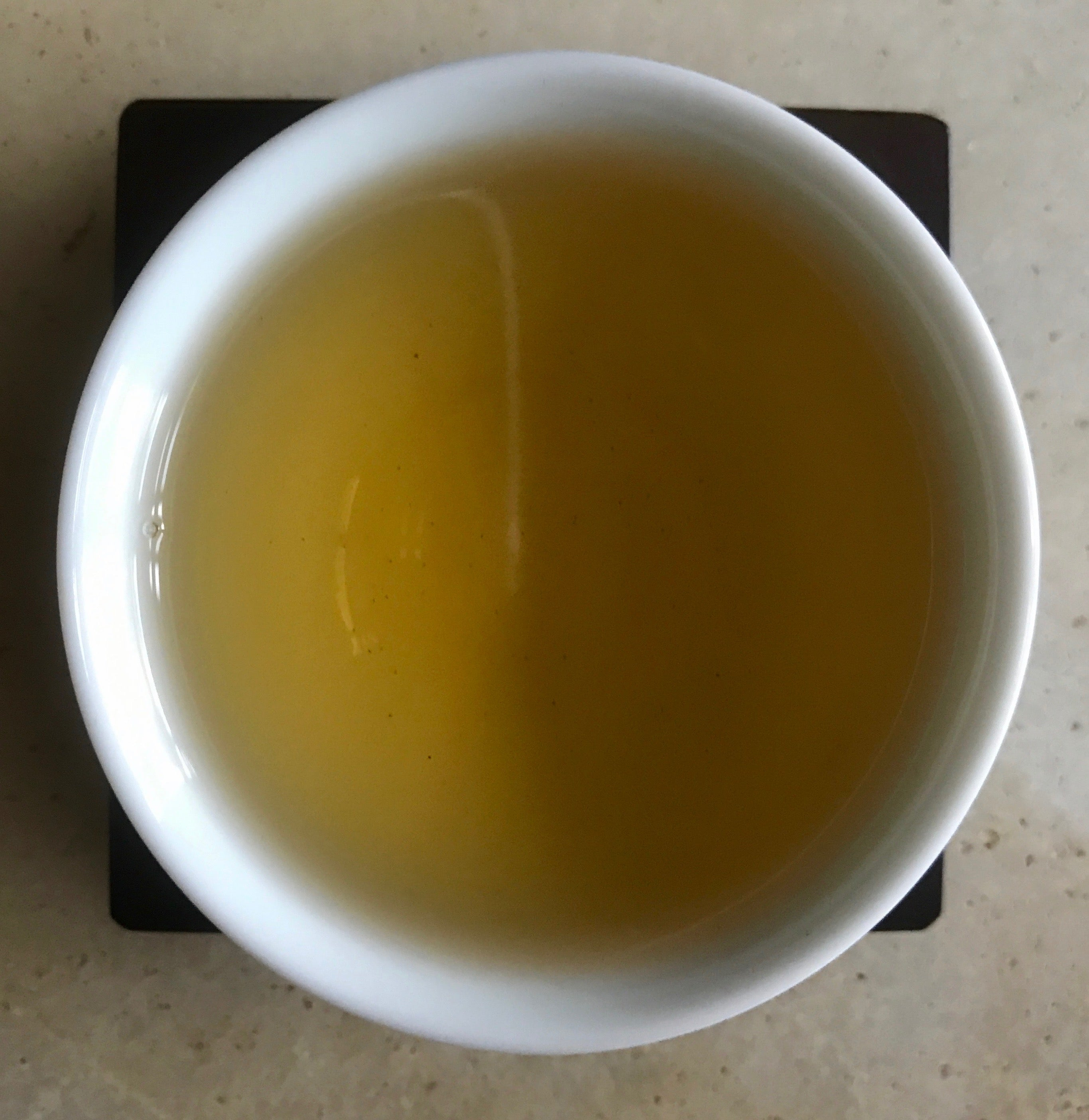 Traditional Lugu Oolong Tea brewed tea in a cup