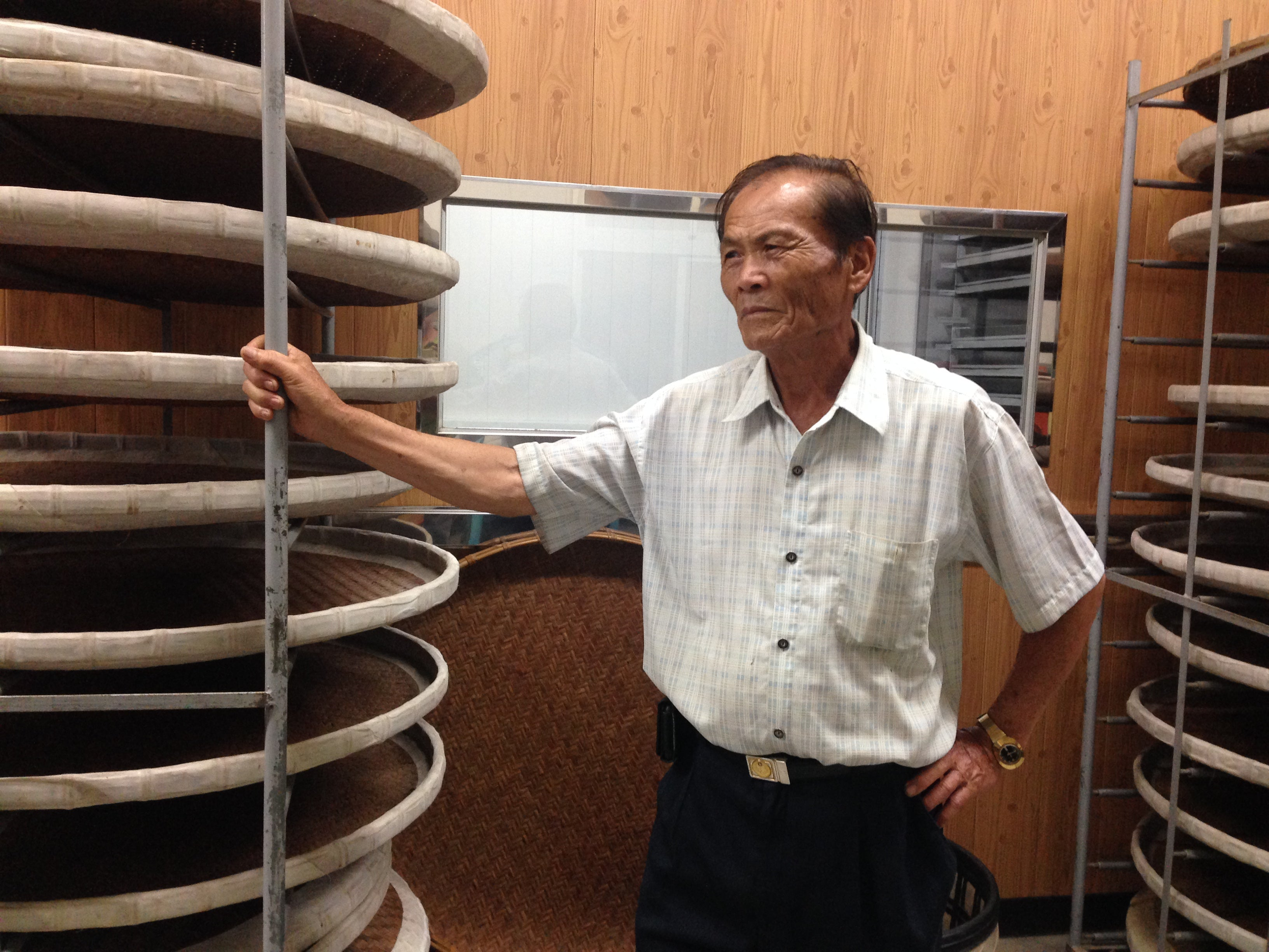 Local elder craftsman supervises a traditional tea making seminar