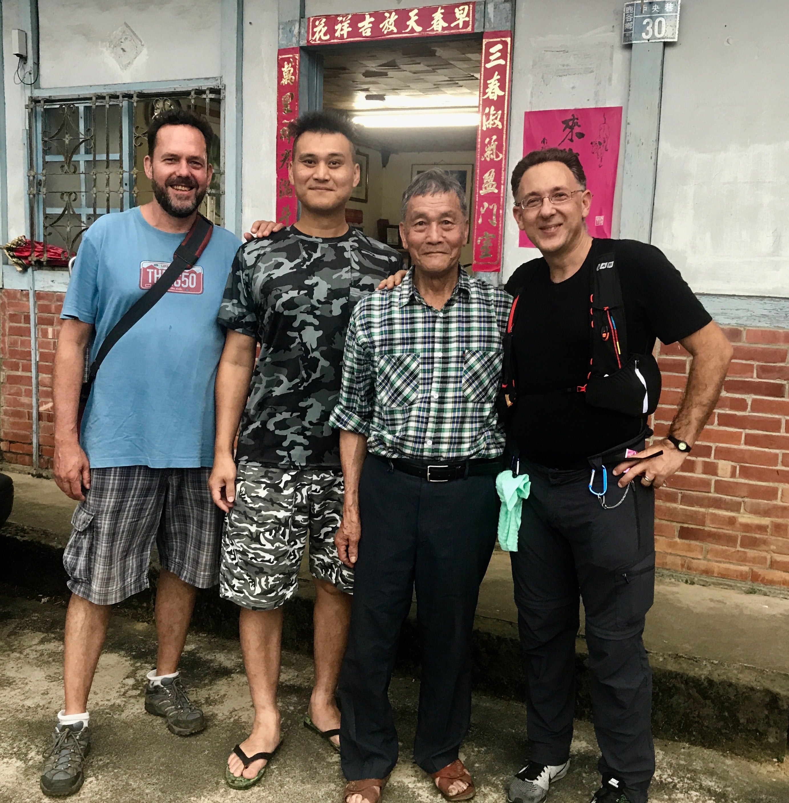 Eco-Cha's sourcing director Andy with Grandpa Liu, his grandson, and Italian guest Fulvio Alba in the home of a world class artisan of Oolong Tea