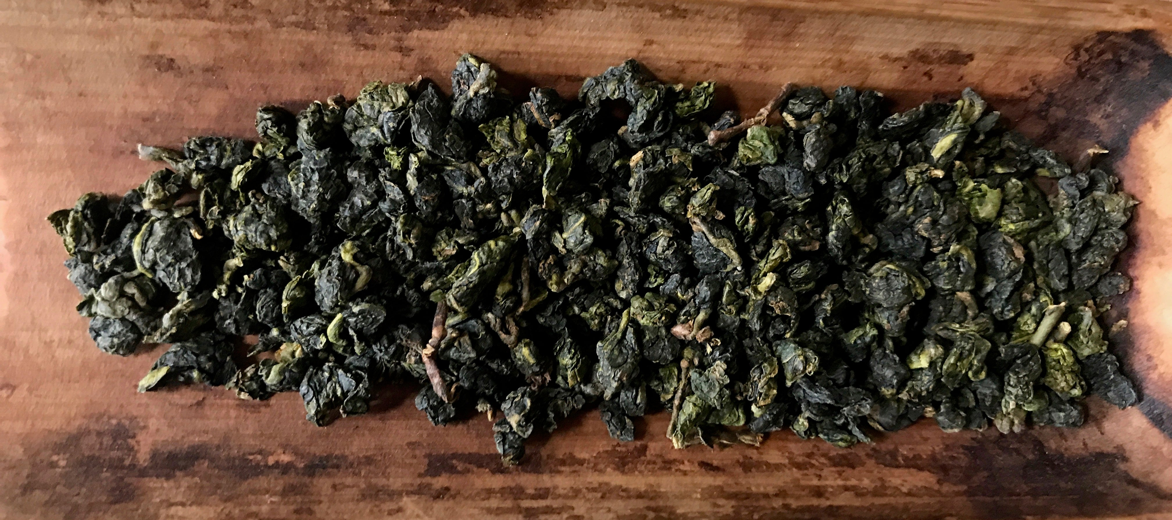 Eco-Farmed Dong Pian Jade Oolong Tea leaves in their rolled and dried form
