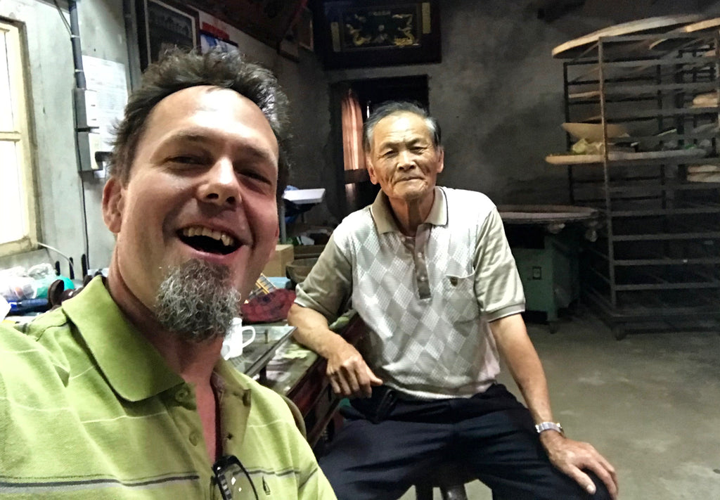 Andy from Eco-Cha Teas poses with Mr. Su in his tea workshop.