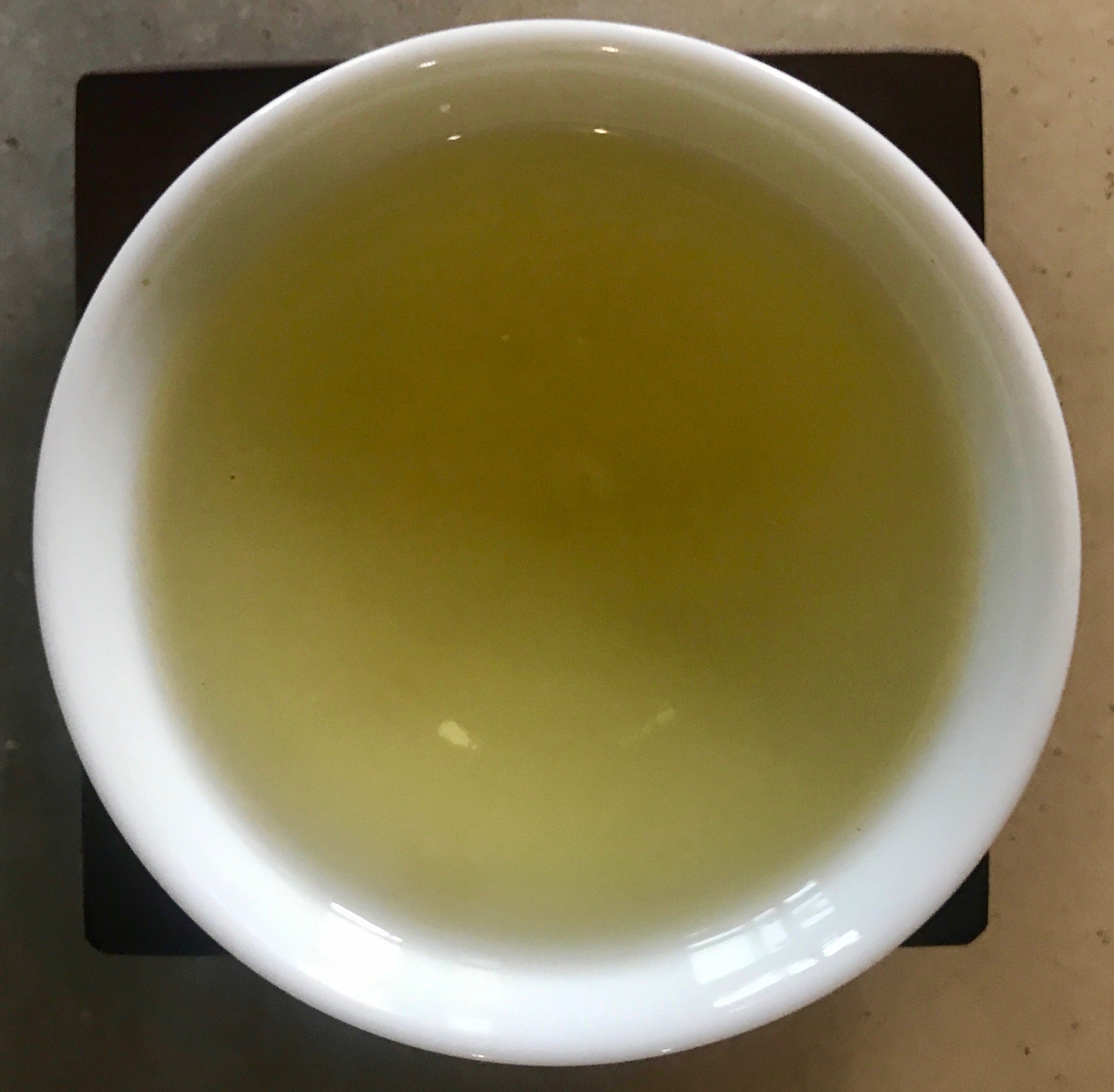 Long Feng Xia High Mountain Oolong brewed tea in a cup