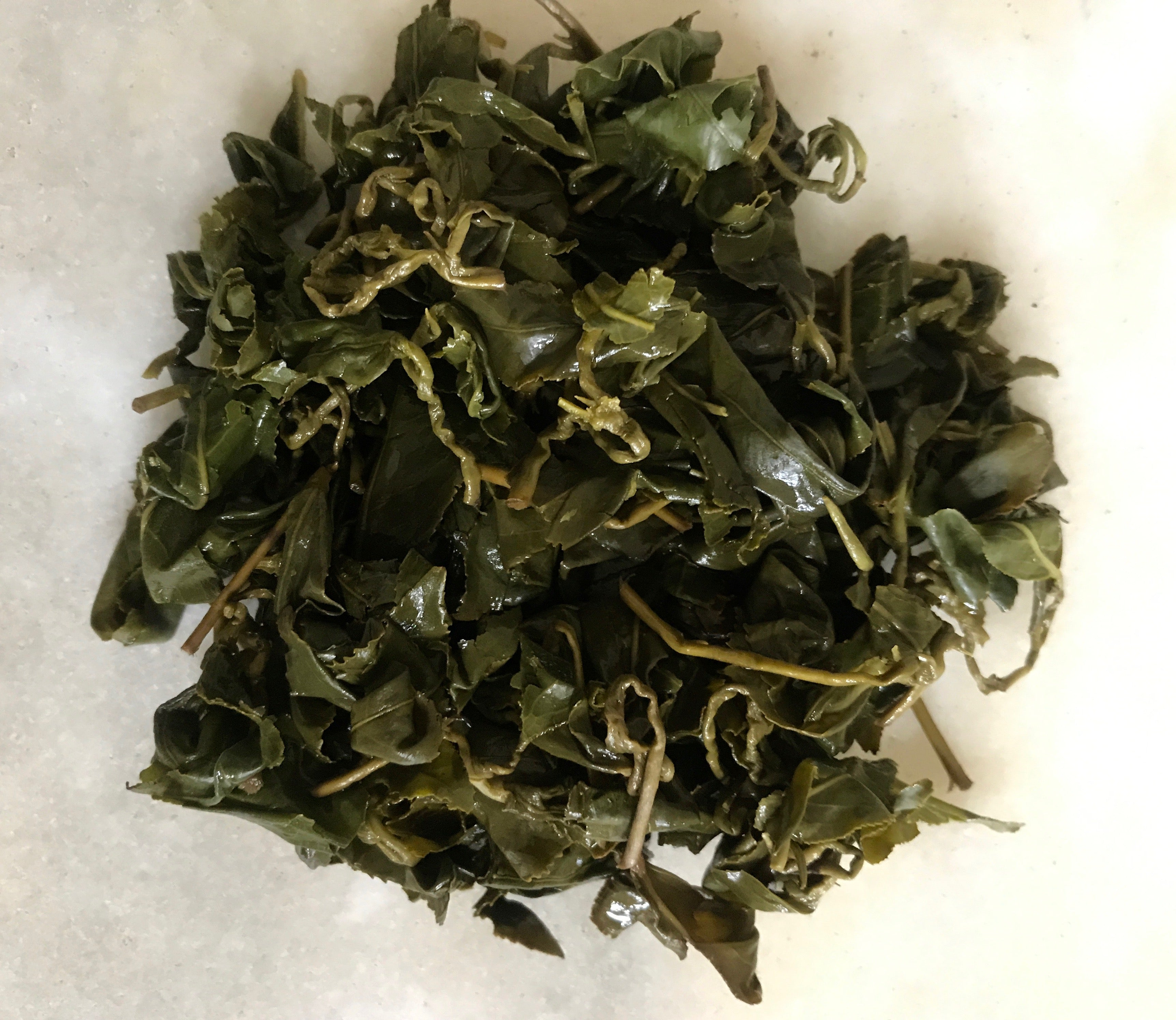 Loose leaf oolong tea leaves after a round of Gong Fu brewing