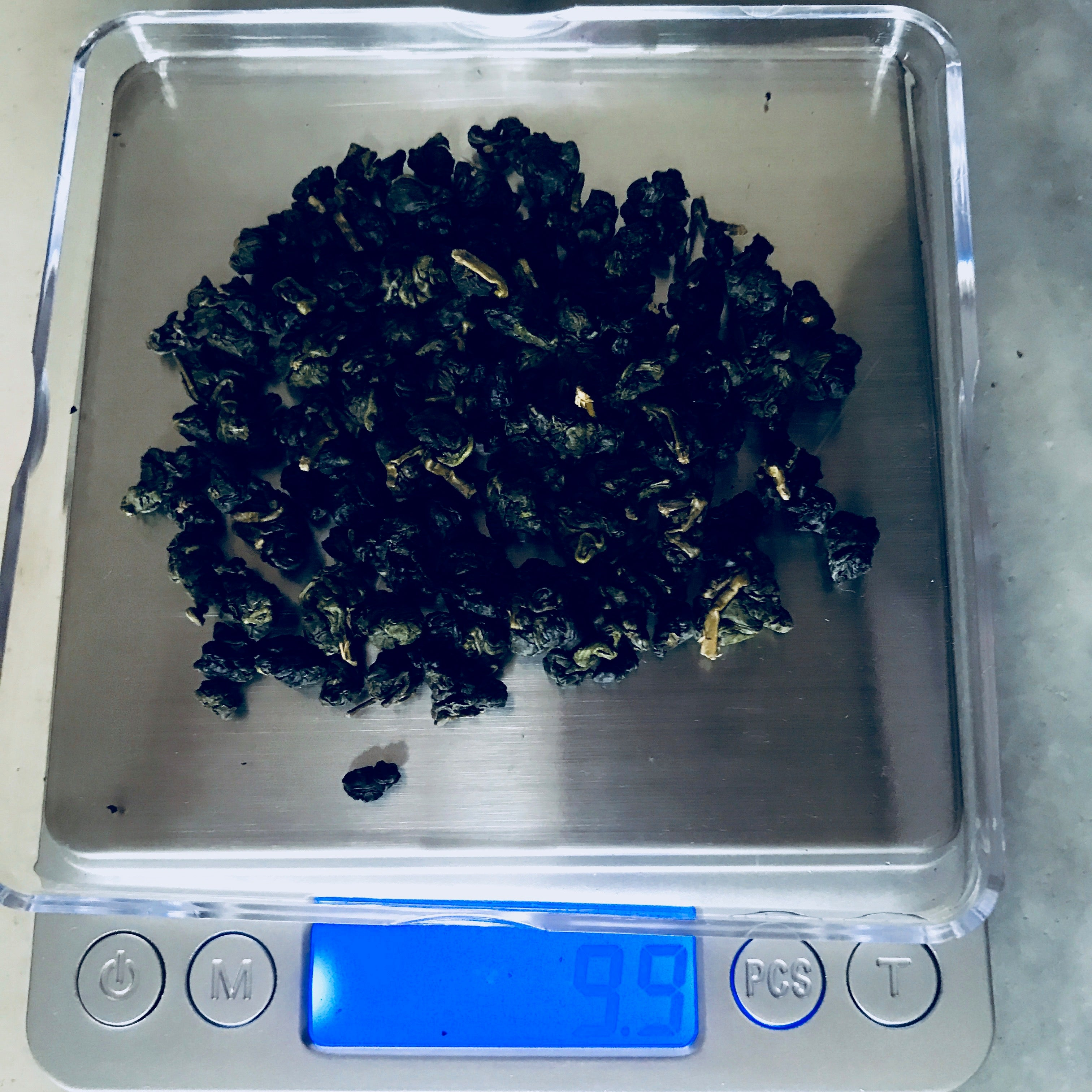 Weighing out the proper amount of loose leaf oolong tea for Gong Fu brewing