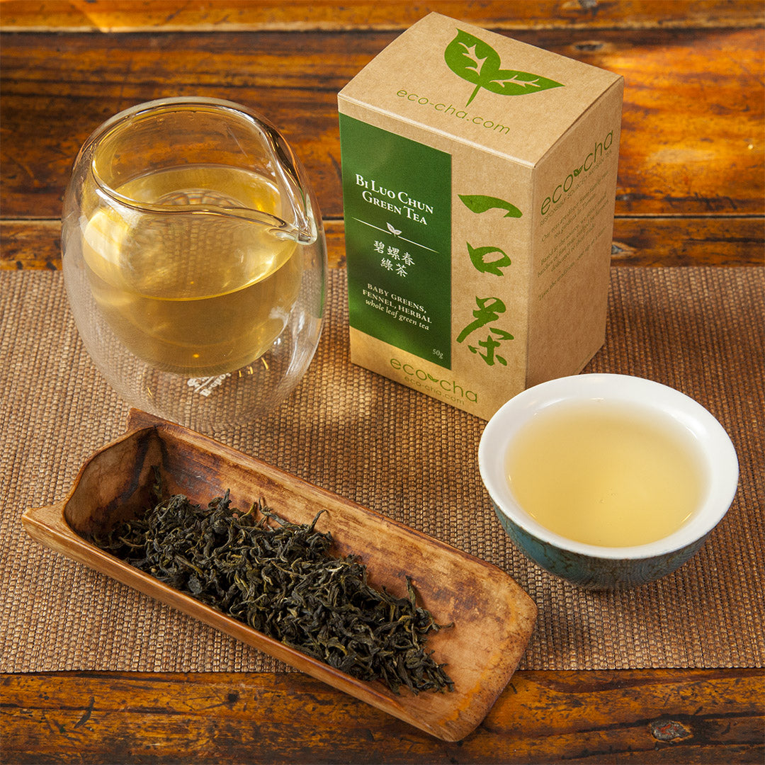 Bi Luo Chun Green Tea dry leaves and brewed in teacup with packaging