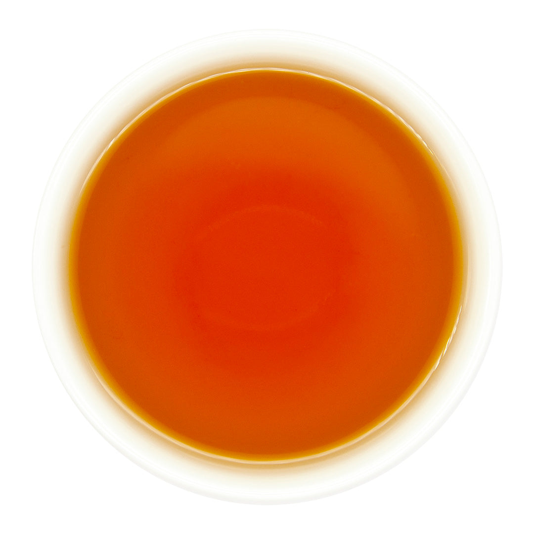 Charcoal Roasted High Mountain Oolong Tea brewed in a teacup, top view
