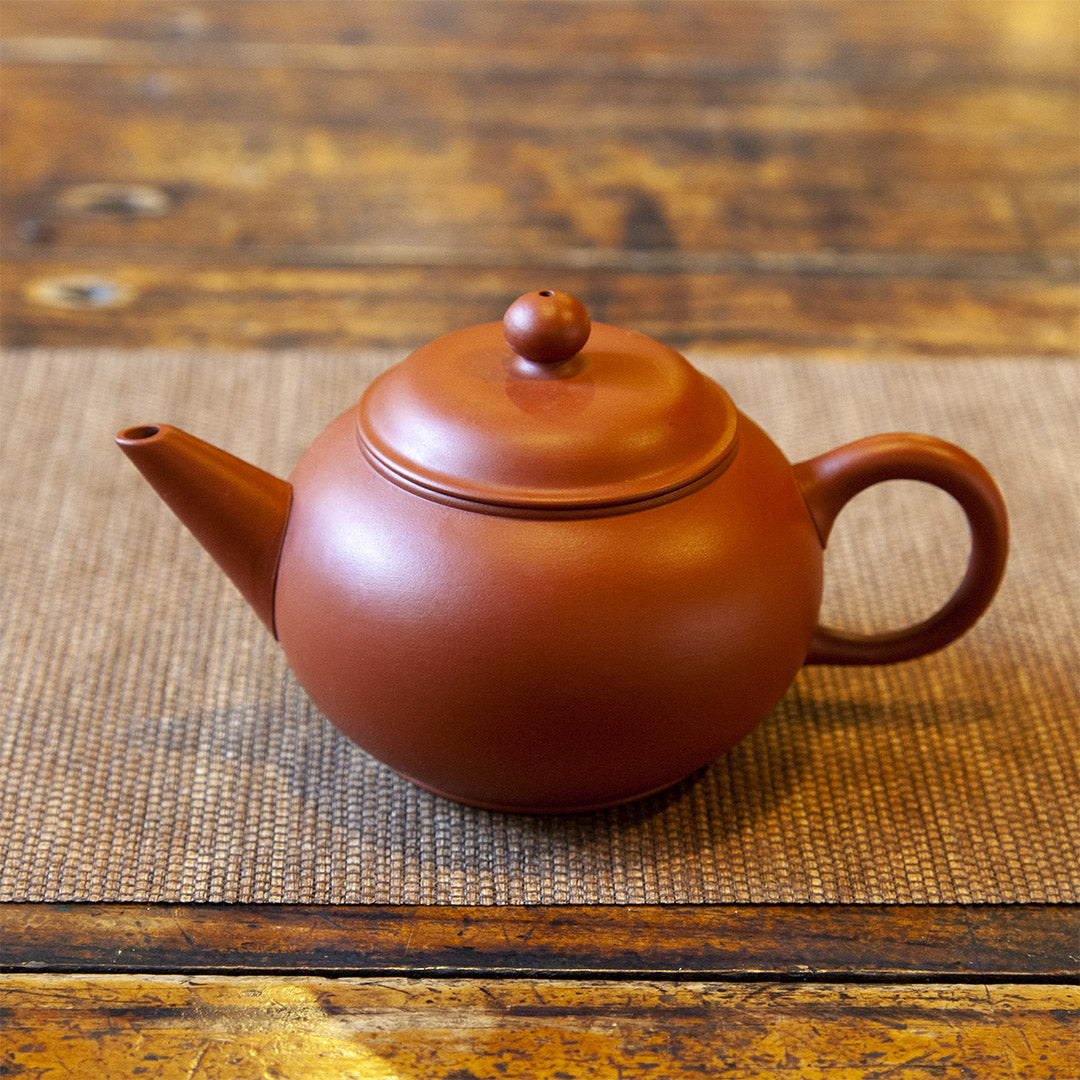 Clay teapot on table