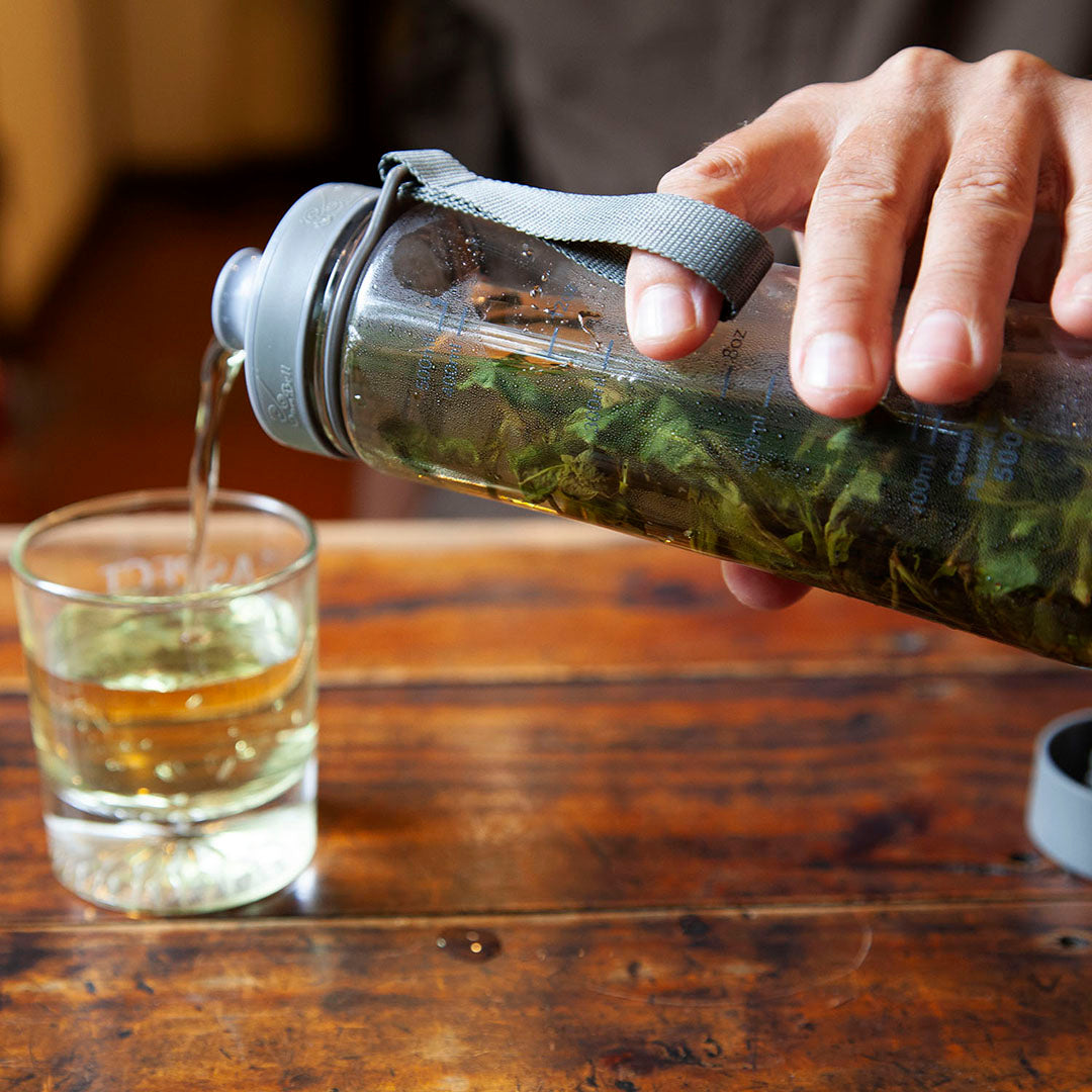 Cold brew tea bottle in use