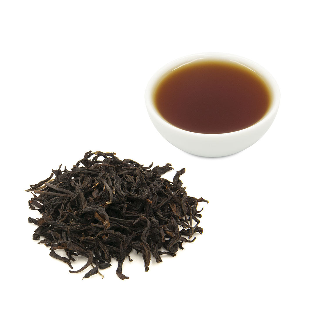 Eco-Farmed Four Seasons Spring Black Tea, dry leaves and brewed tea in white ceramic cup - Eco-Cha Teas