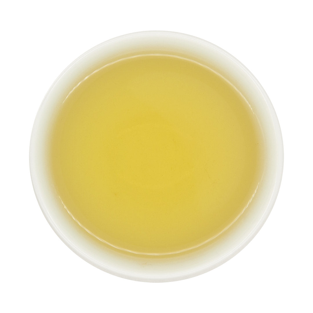 Eco-Farmed Four Seasons Spring Oolong Tea, brewed in a teacup, viewed from top. By Eco-Cha Teas.
