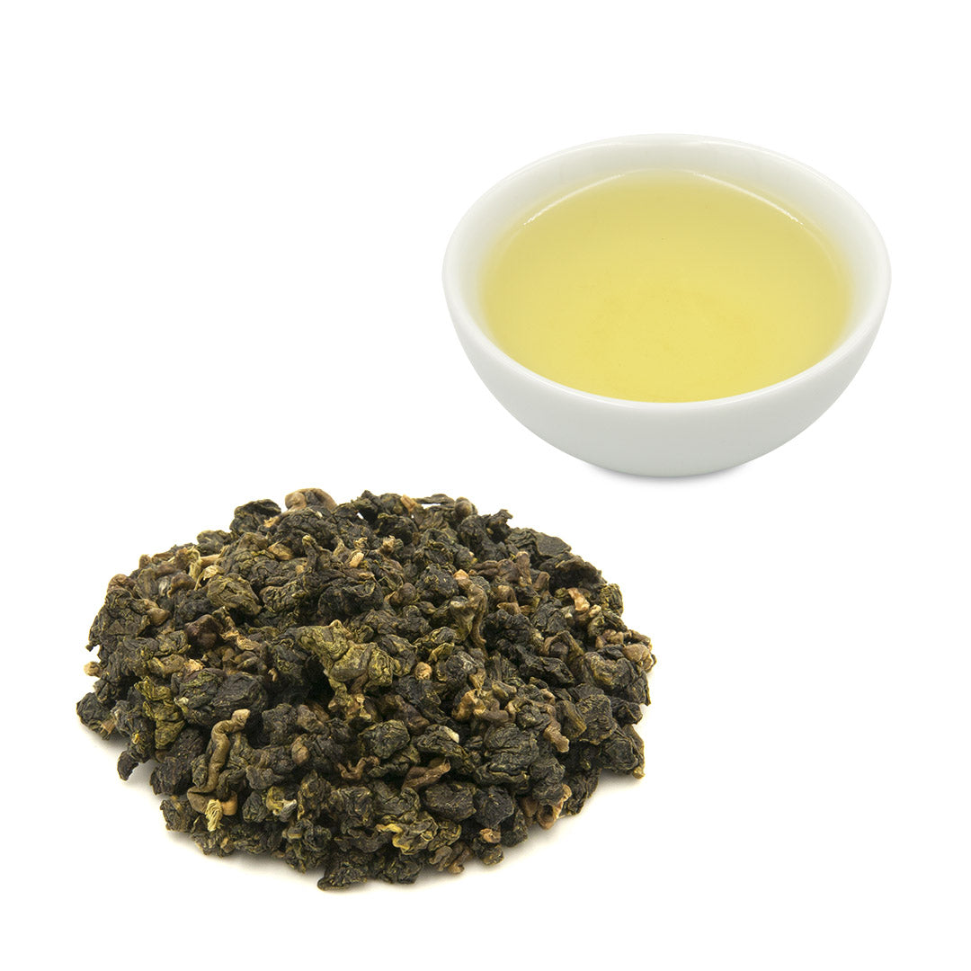 Eco-Farmed Green Tea leaves with brewed tea in cup