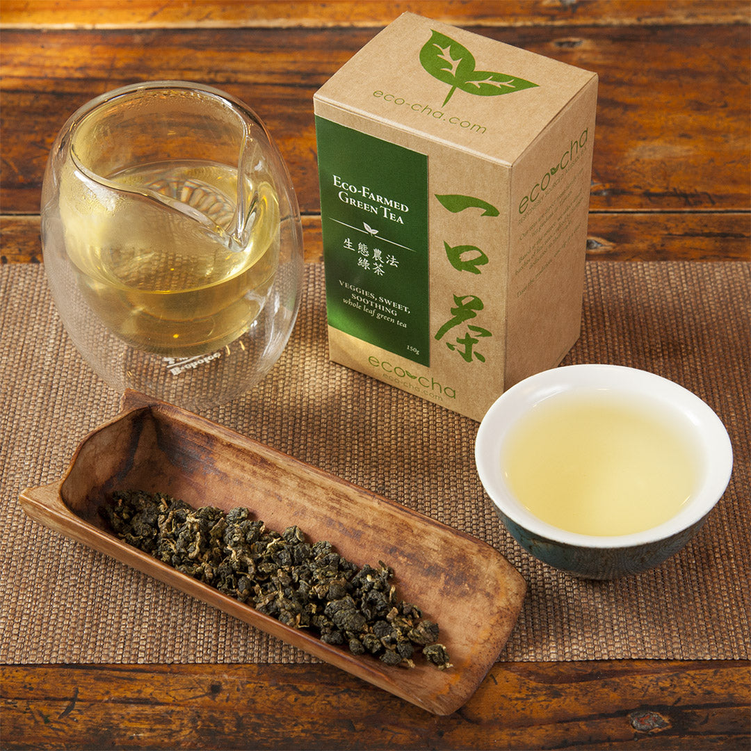 Eco-Farmed Green Tea leaves and brewed tea with packaging