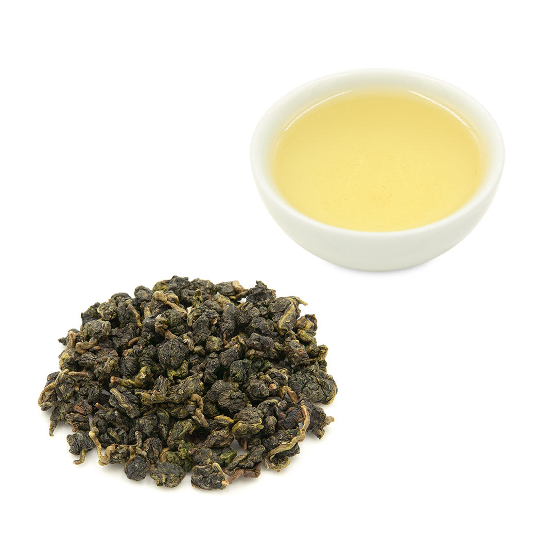 Jin Xuan Oolong tea leaves and brewed tea in cup
