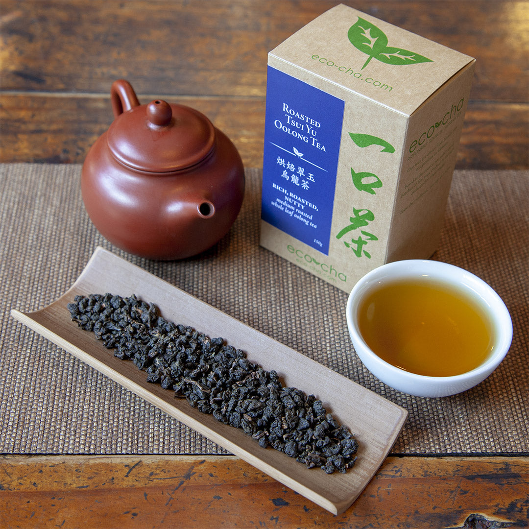 Roasted Tsui Yu Oolong Tea on table with teapot and package box