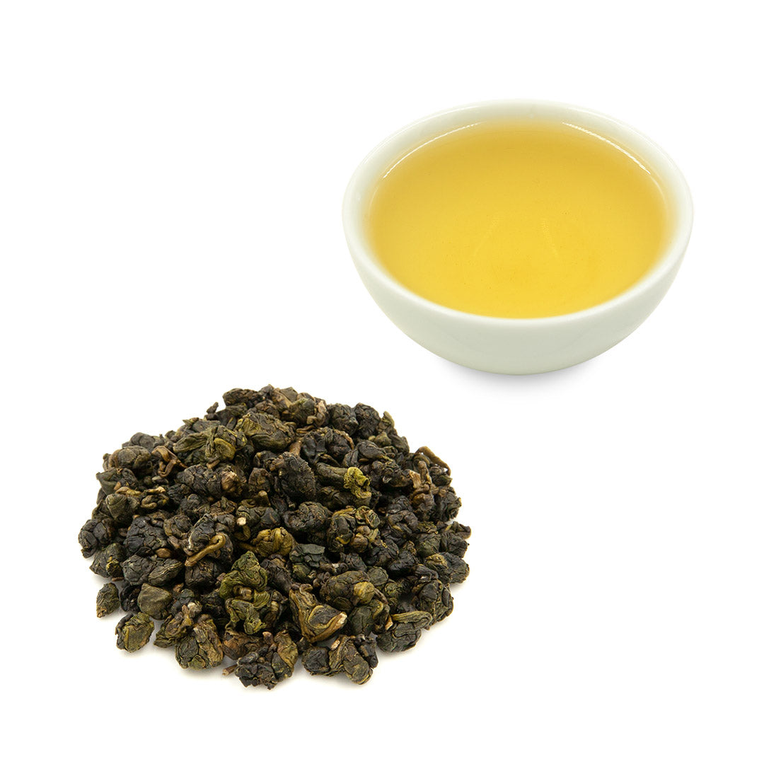 Shan Lin Xi High Mountain Oolong tea leaves and brewed tea in a cup