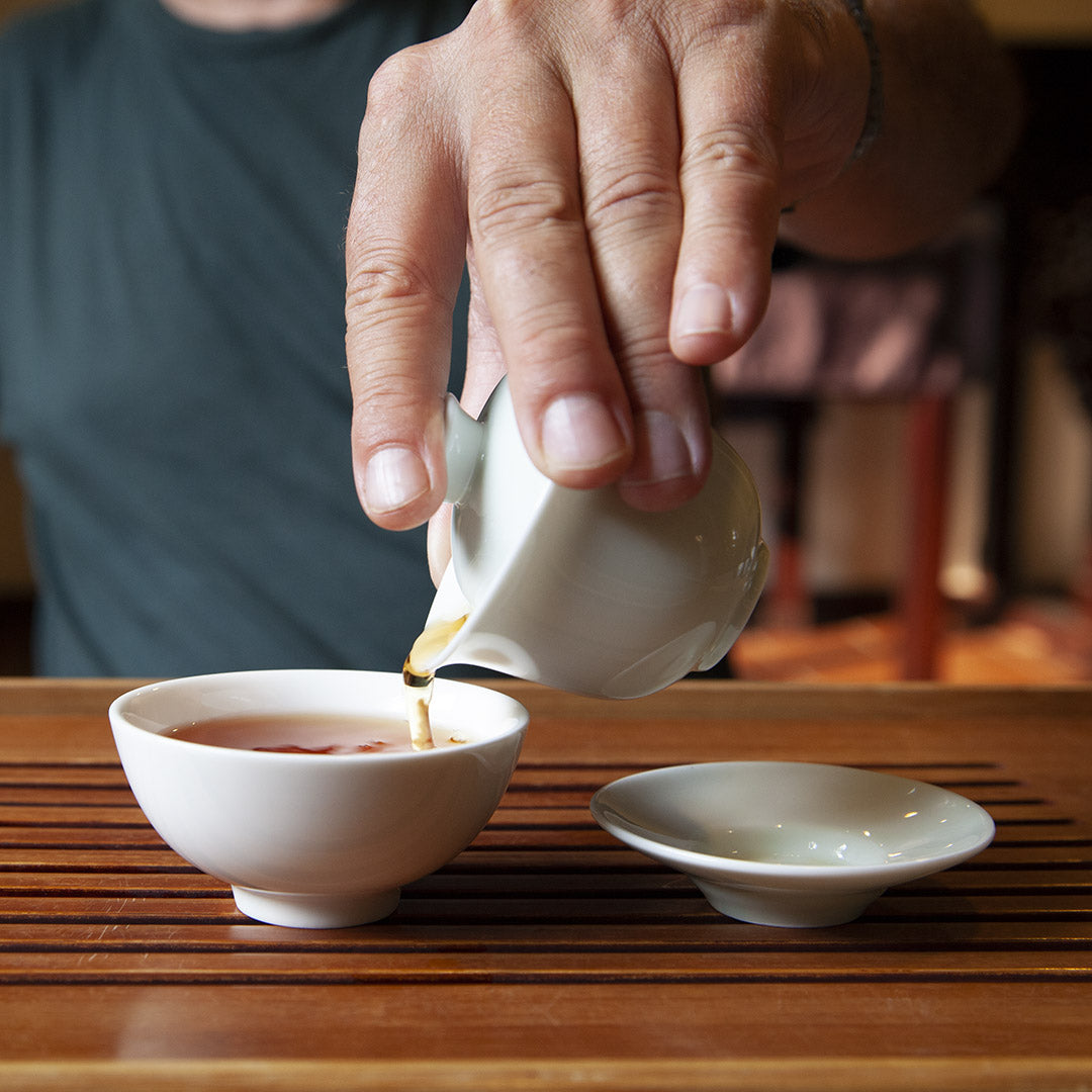 Single serving gaiwan in use pouring tea