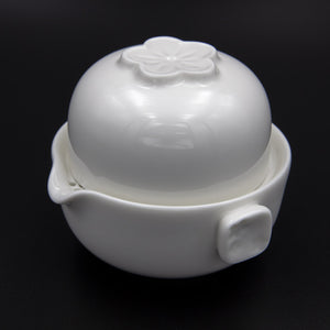 White porcelain single brew teapot and tea cup