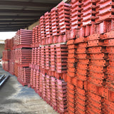 a bunch of used pallet rack beams