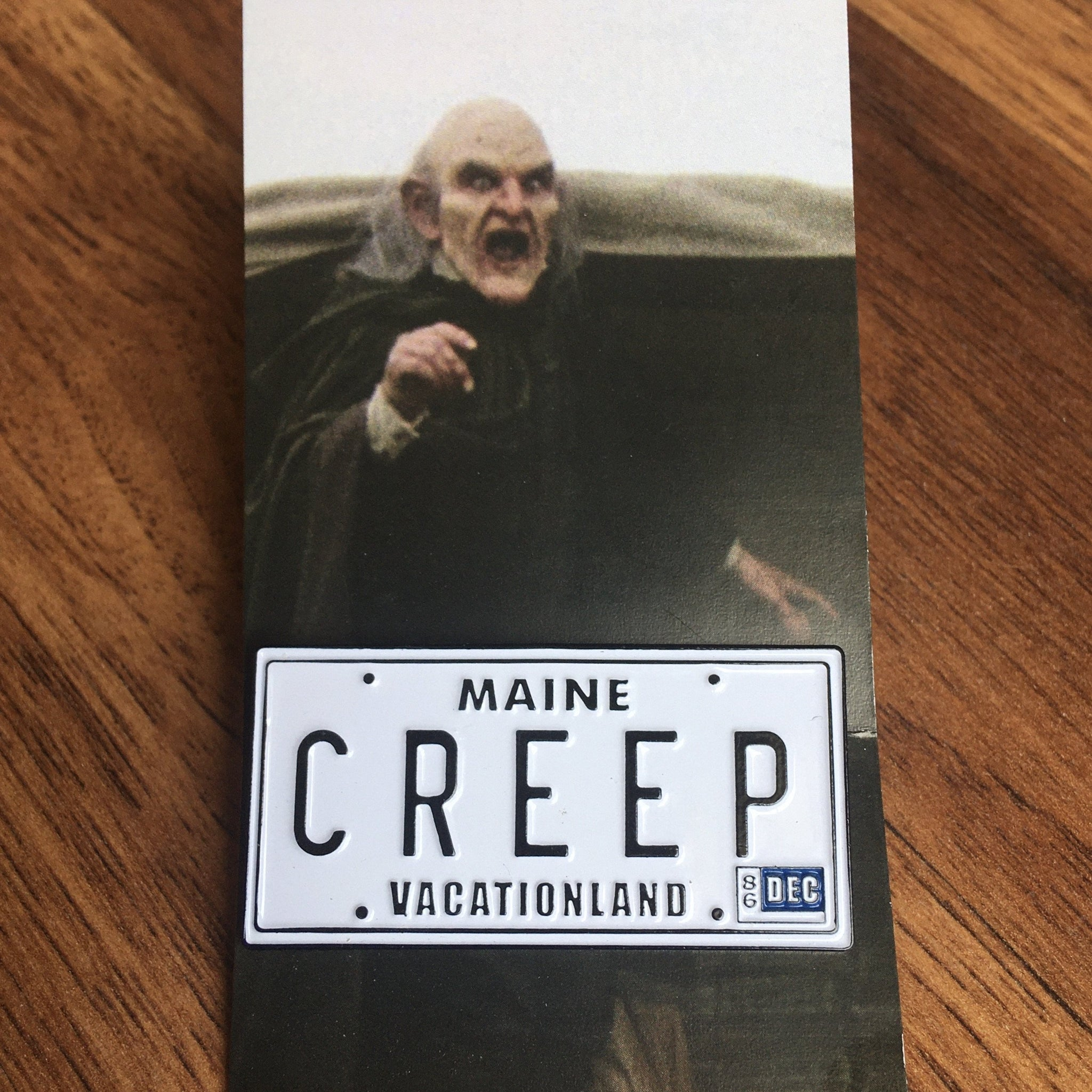 Creep Plate Enamel Pin