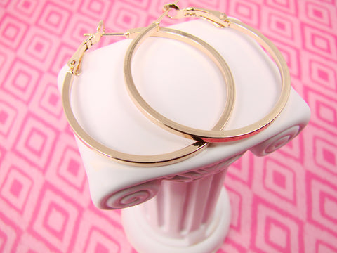 Classic hoop earrings in rose-gold color